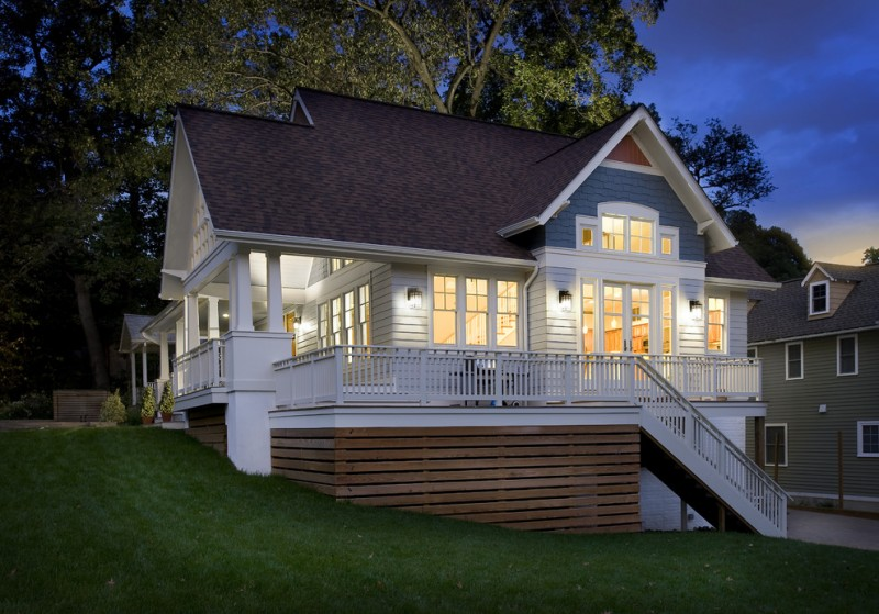 contemporary exterior design with white siding walls glass exterior windows white railing system white exterior stairs and wood deck skirting without finishing