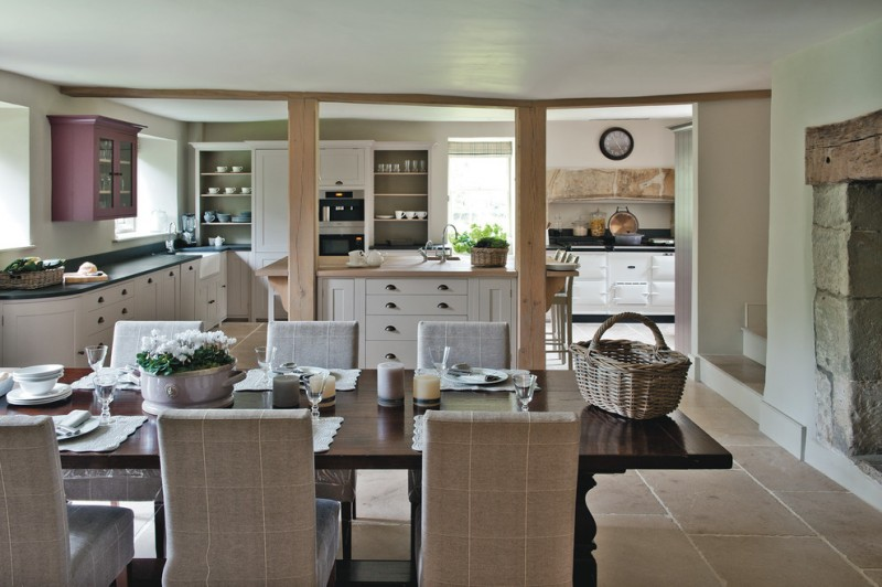 cream chairs lime stone floor dark wooden table raise cabinet white kitchen cabinet ceiling country kitchen appliance wooden basket stone fireplace