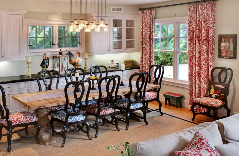 cream wooden table accent fabrics drapes chairs black paint cream rug medium tone wooden floor hanging lamp white cabinets marble countertop