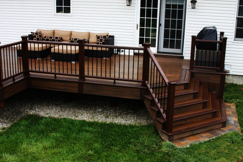 dark wood finished deck with dark wood rails skirt and stairs white exterior brown exterior furniture in modern style