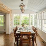 Dark Wooden Table Medium Tone Chairs Floor Cream Veneer Stone Wall Hanging Candle Lamp Glass Framed Window White Deck Ceiling