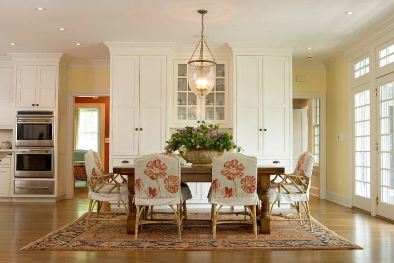 dining cabinet carpet floor to ceiling cabinets door carpet traditional style room chairs table flowers hanging lights ceiling lamps