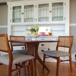 dining cabinet wood floor chairs table overhead cabinets drawers flowers transitional room