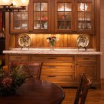 Dining Cabinets Chairs Table Carpet Wood Floor Brown Cabinet Plates Lamps Traditional Style Room