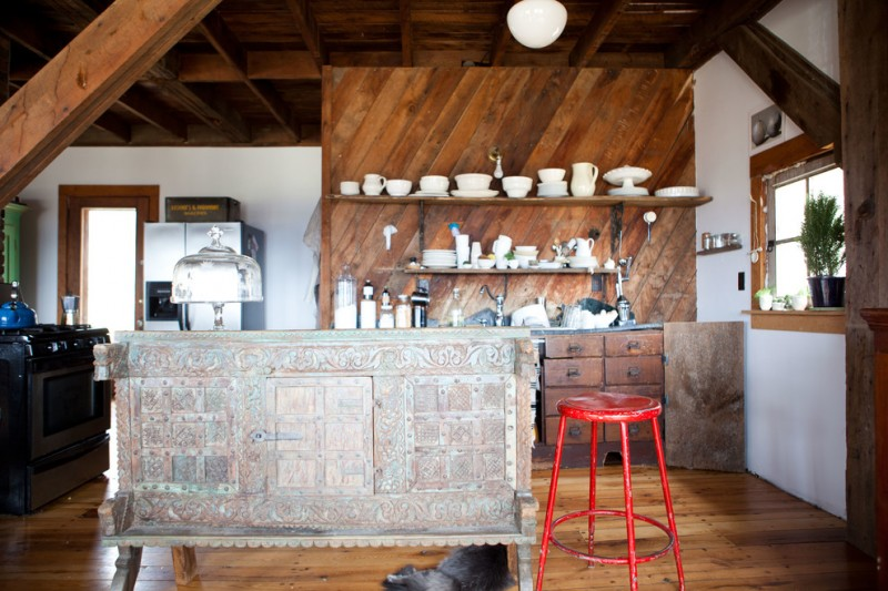 eclectic kitchen design with reclaimed wood wall wood open shelves kitchen island with zinc accent bright red stool medium toned wood floors stainless steel appliances