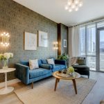 Eclectic Scandinavian Furniture Austin Living Room Cream Rug Blue Couch Artistic Wallpaper Four Leg Round Table Exotic Lamp