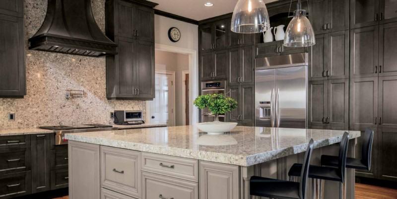 exodus white granite countertop exoduse granite backsplash floor to ceiling dark cabinet wood hood glass ceiling lamps