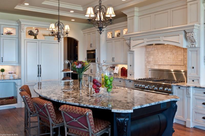 exodus white granite countertop white cabinet tiled backsplash pendant lights