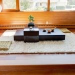 floor seating dining table carpet mat beautiful light big windows glass decorative plant wood floor