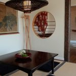 floor seating dining table wood floor painting plant hanging lamps asian dining room