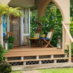 Front Porch In Tropical Theme A Couple Of Wood Exterior Chairs With Pop Colored Comforter Soft Toned Wood Floors