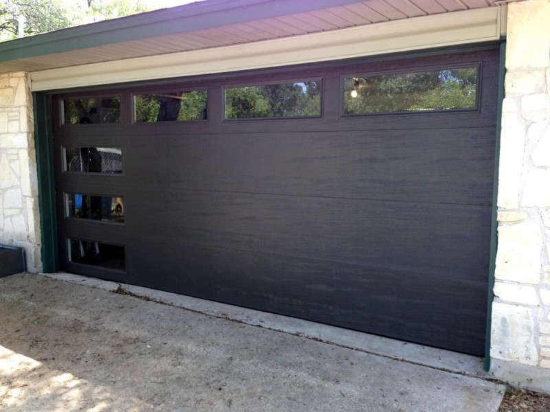 glass garage window dark garage brick wall square garage window