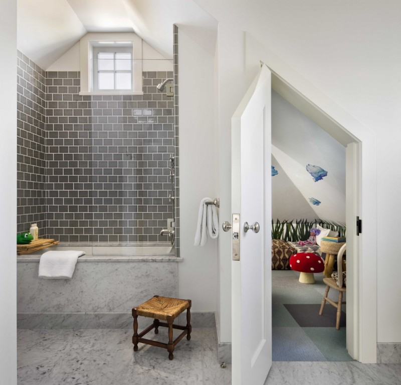 grey small bathtub with shower faucet on top
