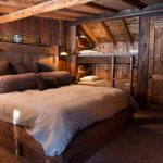 guest bed ideas brown pillows lamps ladder small beds stones wooden walls rustic bedroom