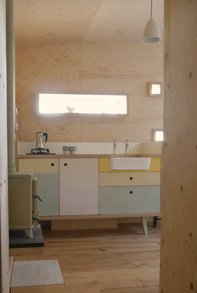 hand built wood kitchen with pop color cabinets white farmhouse sink plywood kitchen walls white pine kitchen floors