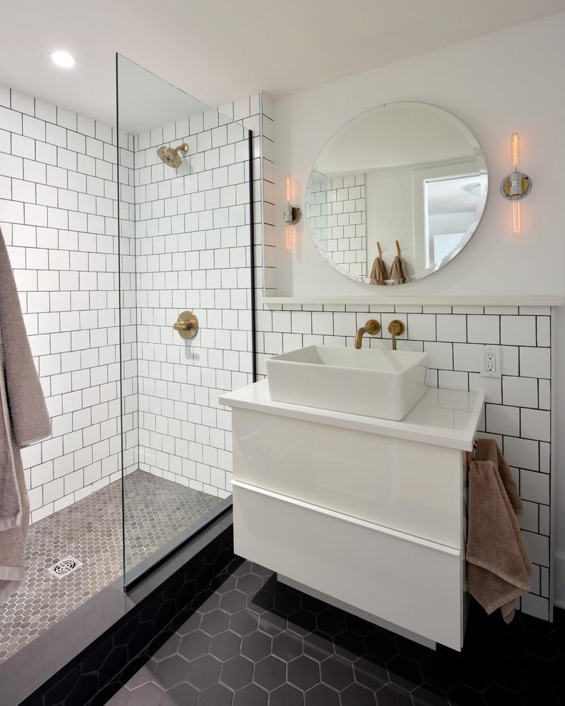 hexagonal black floor tile white tile glass door shower room white cabinet sink round mirror