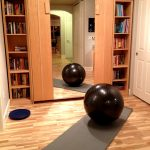 Home Gym Area Grey Yoga Mat Miirored Cupboard Bookshelf Corner Space Wooden Furniture