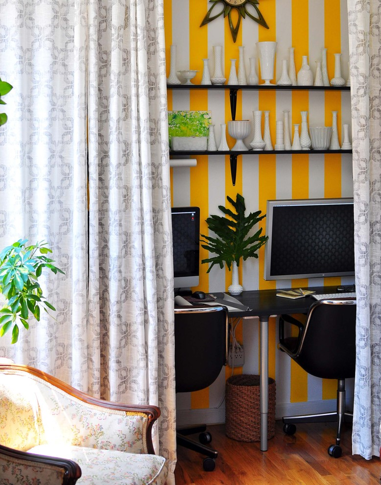 home office hidden in curtain track of beige, yellow white stripped wall, wooden floor, rattan basket, plants, clock, white chinas, dark brown chairs