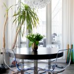 Ikea Electic Dining Table Arctic Pear Chandelier Colourful Rug Transparent Glass Chair Wooden Table Flower Vase Tall Window