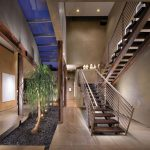indoor planting idea contemporary staircase painting stairs plants pillars pebbles interior