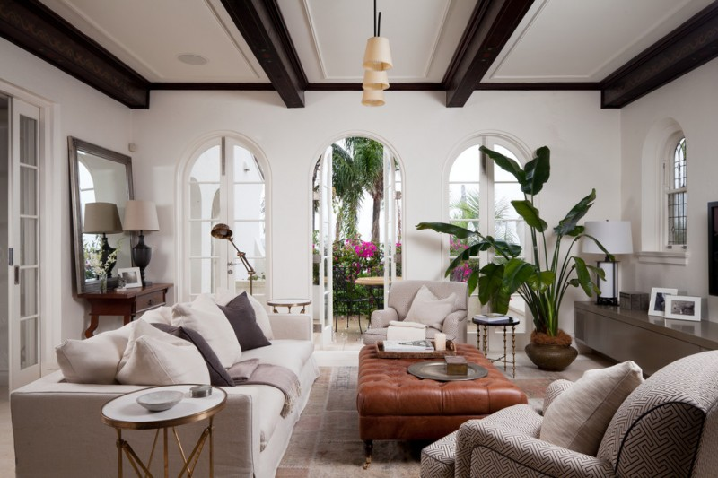 indoor planting idea mediterranean living room table chairs pillows windows mirror small tables