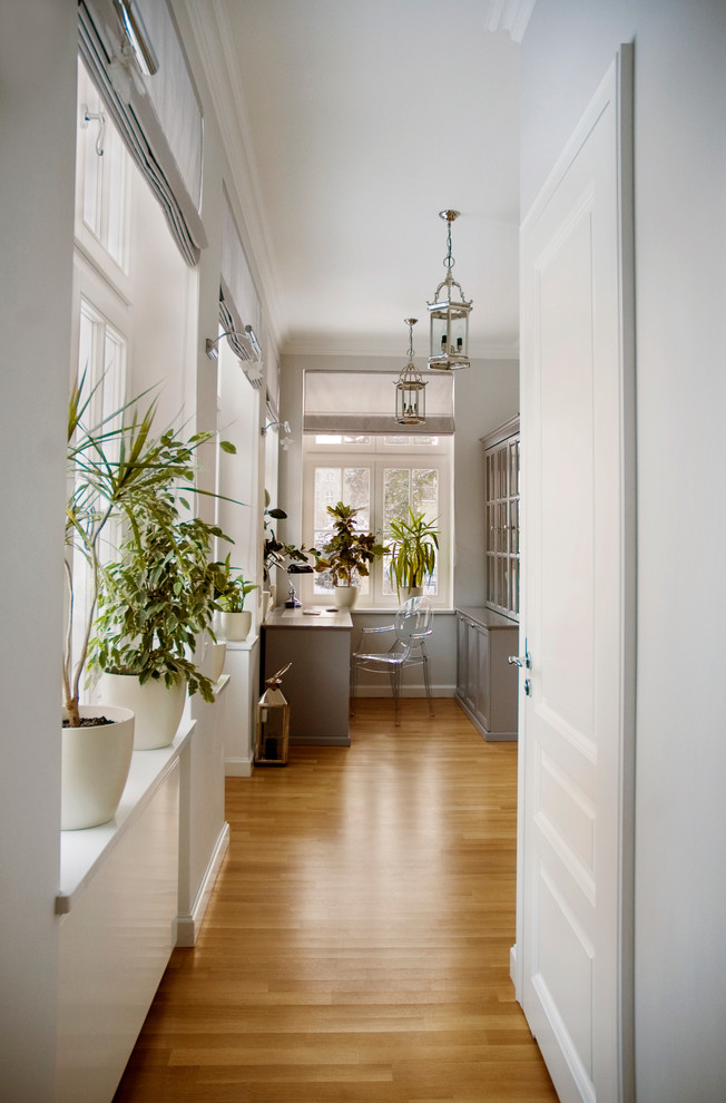 indoor planting idea traditional home office chair table windows storage space light colored walls door plants