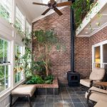Indoor Planting Idea Traditional Sunroom Floor Tile Fireplace Brick Walls Chairs Windows Ceiling Fan