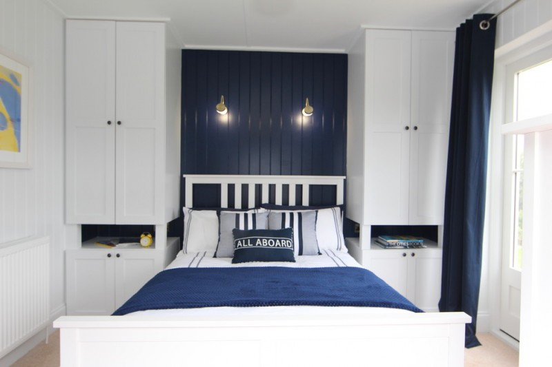 interior designs for small space bedroom bed pillows blue white cabinets curtain painting wall lamps