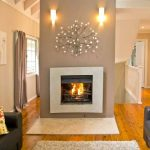 Interior Designs For Small Space Living Room Wood Floor Carpet Sofa Pillows Railing Wall Lights Fireplace