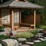 japanese garden exhibition model flowers stones building wooden fence benches water asian landscape