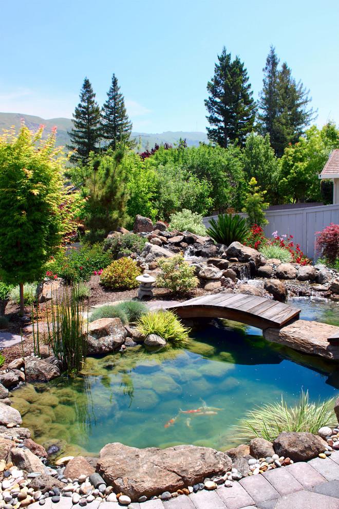 japanese garden exhibition model pond koi fish stones flowers small bridge red green asian landscape