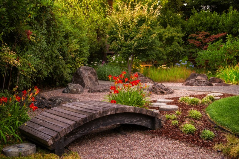 japanese garden exhibition model small bridge flowers grass stones plants beautiful landscape
