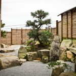 Japanese Garden Exhibition Model Stones Fence Glass Windows Tree Flowers Asian Landscape