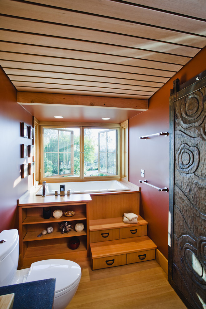 japanese style step up soaking tub in farmhouse bathroom