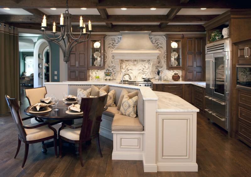 l shaped kitchen stainless steel appliances, marble countertops, raised panel cabinets, dark wood cabinets, dark hardwood floors, island chandelier lamp