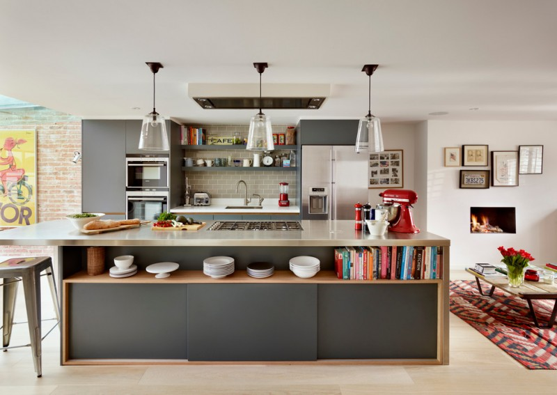 large kitchen with steel countertop, grey cabinet unit for oven refrigerator, white top on sink, glass pendant lamp