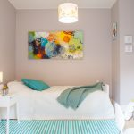 Light Grey Painted Walls Idea Accented By An Abstract Hand Painting Blue White Stripes Area Rug Simple White Bedside Table Modern Pendant Lamp With Yellow Carved Decoration
