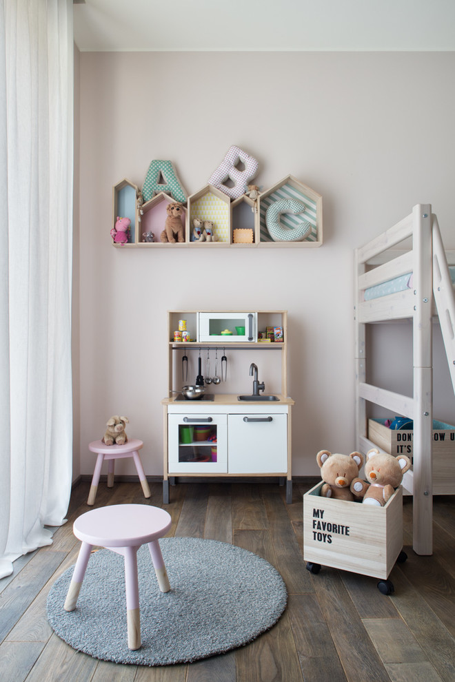 light grey wall painting idea with house shaped shelves small and round rug under pink side chair wood box for animal stuffs with wheels simple console table in vintage style