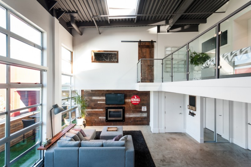 living room with wood wall horizontal paneling at the back of the TV