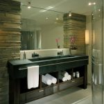 Long Green Marble Sink With Two Faucets, Long Towel Rack In Front Of The Towel Shelves Under The Sink
