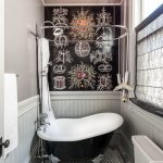 Long Small Bahtroom With Clear Glass Globe Pendant, White Black Mosaic Tiles Flooring, White Wainscot, White Black Toilet And Bathtub With Curtain And Shower