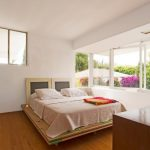 Low Base Wood Bed Design With Headboard Clean White Walls With Glass Windows Wood Floors
