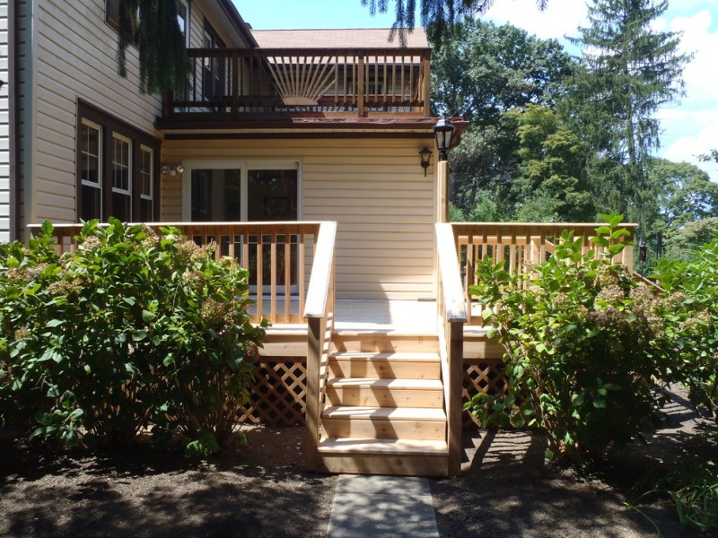 low level lattice deck skirting idea unfinshed wood railing sysem white siding exterior idea exterior glass door with white frames