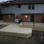 lumber deck with wooden deck skirt and black stained aluminum deck rails red walls for exterior