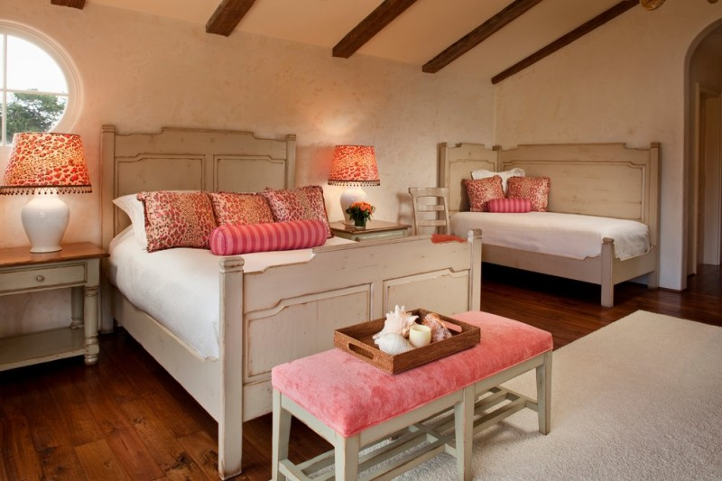 mediterranean queen bed and single bed with corner headboard in white tainted wooden bedding, white bed cover and pink pillow cover