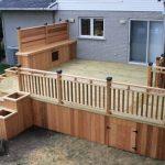 Modern Deck With Cedar White Pine Skirting Cedar Rails Idea Grey Brick Walls Glass Exterior Windows