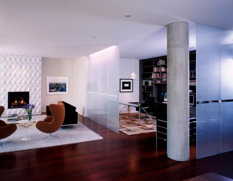 modern living room with big screen and sofa hardwood floor table chairs flowers fireplace lighting bookshelves carpets