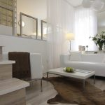 modern room with big screen and sofa pillows stairs carpet decorative plant contemporary style