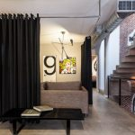 Modern Room With Big Screen And Sofa Stairs Brick Walls Table Black Screens Contemporary Style