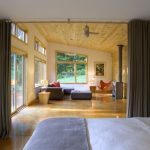Modern Room With Big Screen Sofa Pillows Bed Ceiling Fan Table Windows Lights